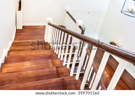 view of wooden glossy stairs...