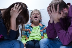 View of yelling boy with educational problems