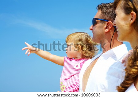 view of young family hanging out in summer environment. Focused on baby's face.