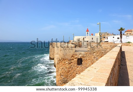 View on a fortification wall of an old city Akko, Mediterranean sea and St.John's Church(Israel) - stock photo