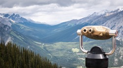 View on alpine valley with tower viewer in foreground ,shot at Sulphur Mountain Lookout, Banff National Park, Alberta, Canada