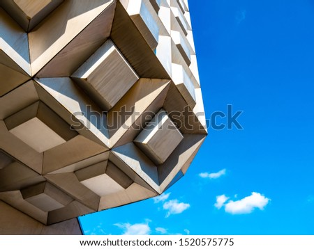 View on an old modern mall building on a sunny day photographed in an unusual perspective. #1520575775
