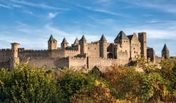 View on autumn trees and old city of Carcassonne. Languedoc. Occitanie region. Southern France