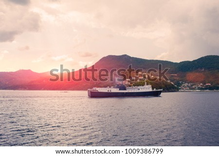 View on big ferry and greek island Kefalonia on sunset #1009386799