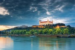 View on Bratislava castle,Parliament and Danube river in autumn sunset, Bratislava, Slovakia