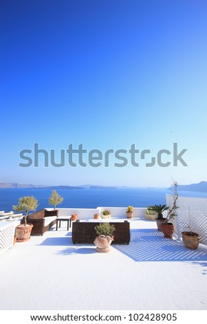 View on caldera and sea from balcony, Santorini, Greece - stock photo