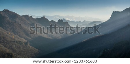 View on Caucasus mountain range with autumn forest valley, Shoana Church viewpoint in Karachaevsk, Russia #1233761680
