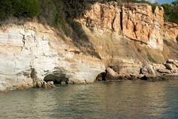 View on cliffs and a few caves on Cape Sarandaris in Crete Island, Greece