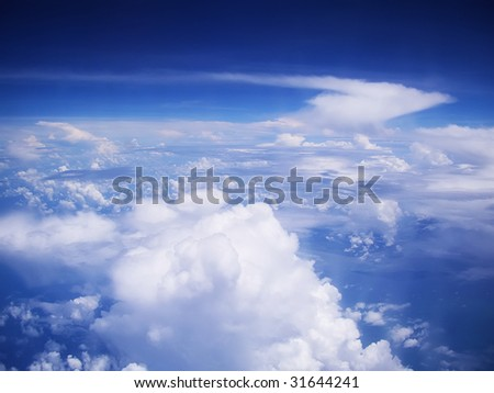 View on cloudscape and blue sky from above