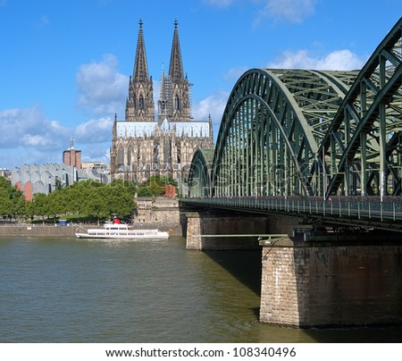 View on Cologne Cathedral and Hohenzollern Bridge over the Rhine river, Germany