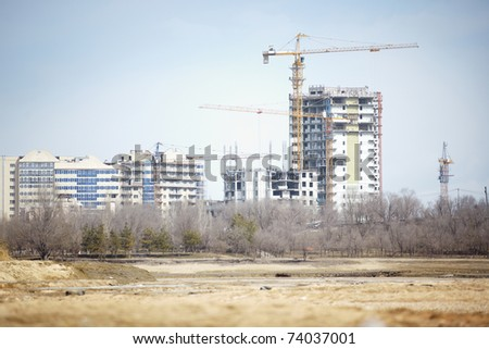 View on construction activity of residential buildings. Natural light and colors