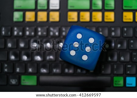 View on dice with number six on keypad with colorful buttons. From above. #412669597