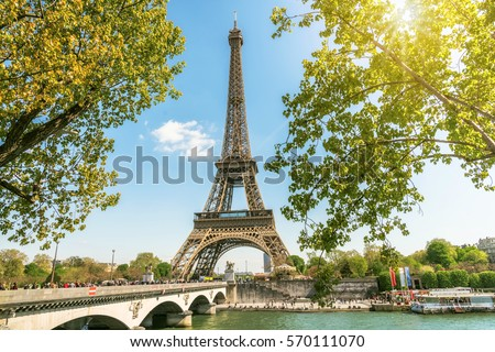 view on Eiffel tower under sunny summer sky