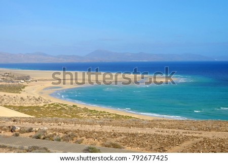 Shutterstock View on famous beach Playa de Jandia - Playa de Sotavento - Playa Lagoon on the Canary Island Fuerteventura, Spain. This beach belongs to the best beaches in the world for windsurfing.