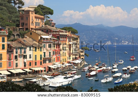 View on famous town of Portofino with small bay full of yachts and boats on Ligurian sea, northern Italy.