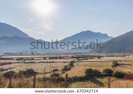 View on fields and mountains at sunset in Greece, Corfu #670342714