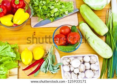 View on fruits and vegetables on old wooden table