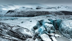 View on glacier Svinafellsjokull in Skaftafell, Iceland during winter season. Hikers group on the slippy glacier. Unusual landscape. Icy World and maybe home of Santa Claus, Christmas Father.