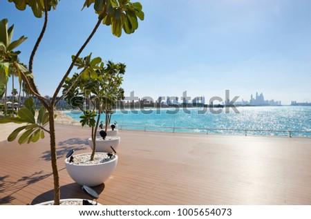View on Jumeirah Beach with in background Madinat Jumeirah and the skyline of Dubai Marina, Dubai, United Arab Emirates #1005654073
