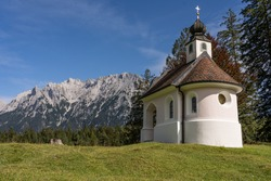 view on karwendel mountains and the chapel maria koenigin (queen maria), bavaria, germany