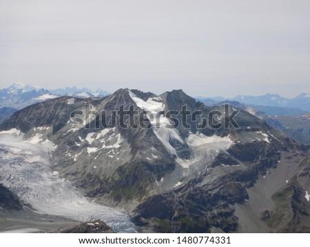View on Les Diablons Alpine peak with Turtmann Glacier underneath viewed from Üssers Barrhorn summit - Many peaks around in Swiss Alps in the Summer