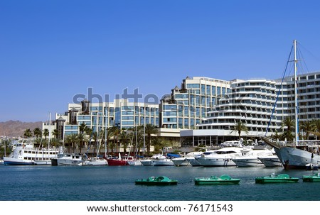 View on marina and docked yachts and boats in popular resort and recreation center of Israel - Eilat city
