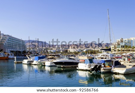 View on marina with moored yachts in Eilat – famous resort and recreation Israeli town located on northern part of the Aqaba gulf, Red Sea