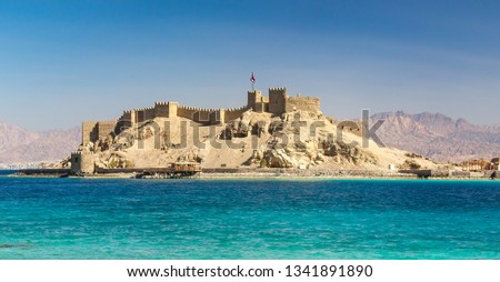 View on medieval Citadel of Saladin on the Pharaoh's Island in the Gulf of Aqaba in Taba region. Old fortress of Sultan Salah ad-Din, ancient monument of an arabic history on Sinai Peninsula, Egypt. Stock fotó ©