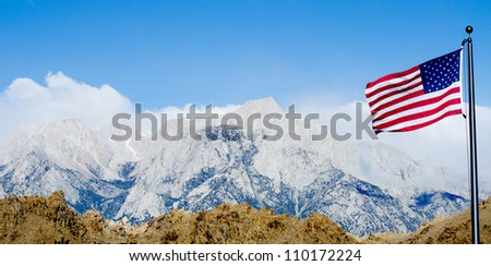 View on Mount Whitney (the highest summit in California and contiguous USA) and Lone Pine Mountain with american flag on foreground
