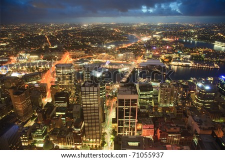 view on night highlighted Sydney CBD city from top Oztrack streets full of lights