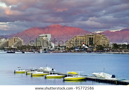 View on northern beach of Eilat city and interesting formation of clouds at sunset, Israel