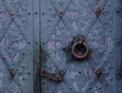 View on old purple door in a catle