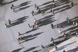 View on people from the tower of St. Mary's Church, Kosciol Mariacki. Background of people with lolg shadows. top view.