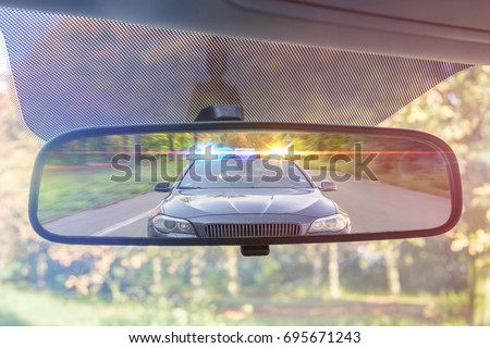view on rear mirror of a car....