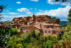 View on Roussillon, small Provensal town with  large ochre deposits, located within borders of Natural Regional Park of Luberon