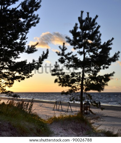 View on sandy beach and Riga gulf at sunset, Dubulti, Latvia