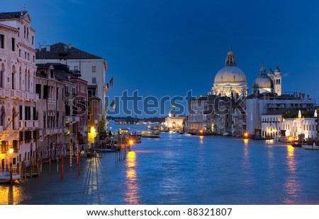 View on Santa Maria della Salute and the Grand Canal from Academy bridge in Venice at night