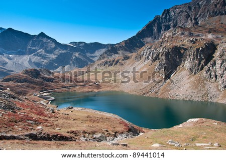 View on small alpine lake among the peaks of Alps in Italy.