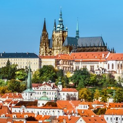 View on St. Vitus Cathedral and  Prague Castle across Vltava river on a brigh Autumn day