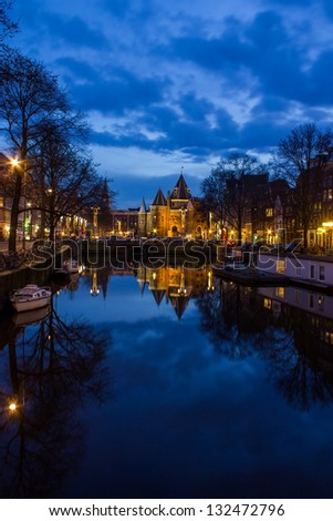 view on the Amsterdam De Waag at the evening