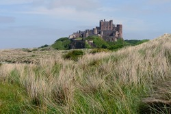 View on the Bamburgh Castle from the northeast with dunes on the foreground