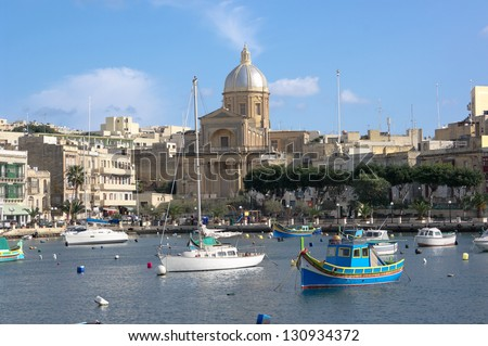 view on the bay of Kalkara Creek with St. Joseph Church, Malta