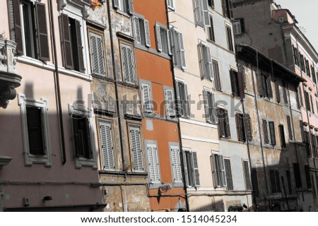 View on the facades of old Roman houses in the former Jewish Ghetto of Rome, Italy