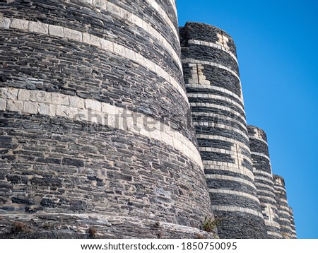 View on the fortress of the castle of Angers. It is an old emblematic monument of the city. Sunny day, blue sky.  Photo stock ©