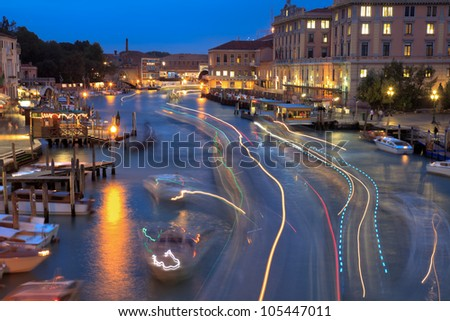 View on the Grand channel at night, canal grande, in Venice with the lights of many boats due to long shutter speed