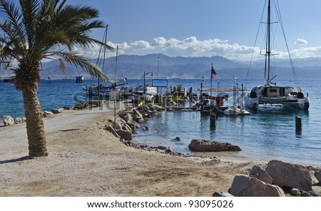 View on the gulf of Aqaba and pleasure touristic boats from the southern beach of Eilat, Israel