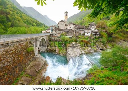 View on the Lavertezzo village, famous tourist destination - An old Swiss village with double arch stone bridge at Ponte dei Salti with waterfall, Lavertezzo, Verzascatal, Canton Tessin