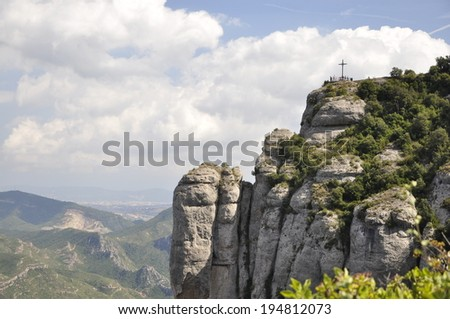 View on the mountain of Montserrat and the cross of St Michael Catalonia Spain