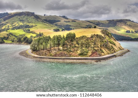View on the New Zealand hills from Otago Harbour Bay, Port Chalmers, South Island.