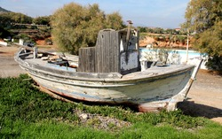 View on the old boat on the beach . Mediterranean. Greece